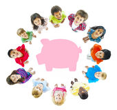 Children Piggy Bank Saving. Children around a piggy bank royalty free stock photos