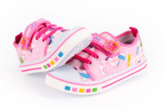Children pink sneakers Stock Photo