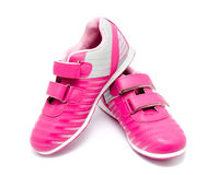 Children pink sport shoes isolated. On a white background stock photo