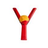 Children& plástico x27; estilingue de s isolado no fundo branco, vermelho Imagem de Stock Royalty Free
