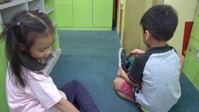 Children are placing their shoes in to locker stock video footage