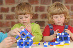 The children during the plaing with construction Royalty Free Stock Photos