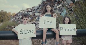 Children for planet Earth. Save The planet. young kids holding signs for saving planet earth stock video