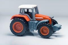 Children plastic toy tractor Stock Photo