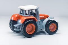 Children plastic toy tractor Stock Photos