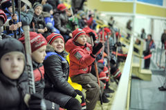 Children on the platform watching the competition on hockey Royalty Free Stock Images
