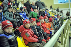Children on the platform watching the competition on hockey Stock Photos