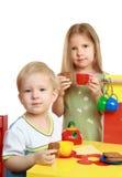 Children play. Family tea drinking Stock Photography