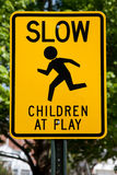 Children at play. Slow - Children at Play sign near playground Stock Photography