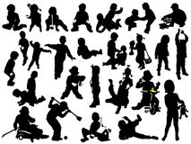 Children play. Silhouettes of young children in the game Stock Photo
