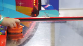 Children play in the air hockey game in the children`s entertainment center.  stock footage