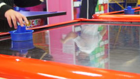 Children play in the air hockey game in the children`s entertainment center.  stock video