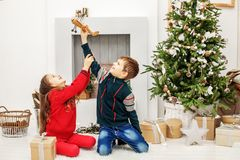 Children play in the airplane in the room. The boy and the girl. Happy Christmas and New Year Concept Royalty Free Stock Images