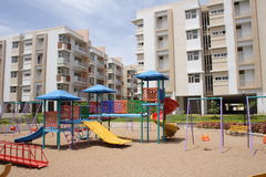 Children play area. Children play equipment with apartment background Royalty Free Stock Images