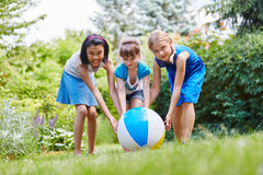 Children play as team with ball Royalty Free Stock Photography