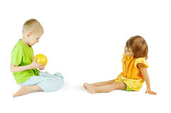 Children play with a ball. Children play a ball a white background Stock Photo