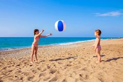 Children play with ball on the beach. Royalty Free Stock Images
