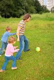 Children play ball with father Stock Image