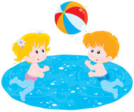 Children play a ball in water Stock Photography
