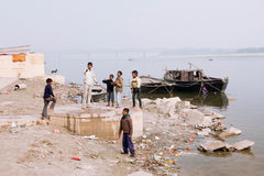Children play on the banks of the River Ganges Stock Image