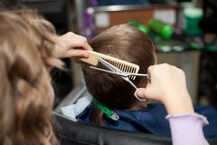 Children play in the barbershop Stock Images