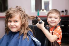 Children play in the barbershop Stock Photography