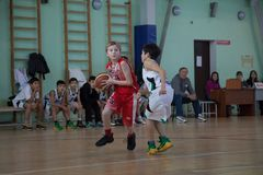 Children play basketball stock images