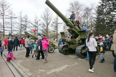 Children play on the big guns, which stand near the museum of the Victory Memorial during the celebration of Victory Day WWII. KRASNOYARSK, RF - May 9, 2018 royalty free stock photos