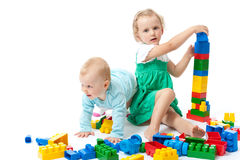 Children play with blocks in studio Stock Images