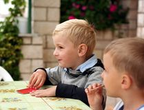 Children play a board game