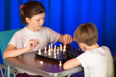 Children play a board game called chess. Royalty Free Stock Image