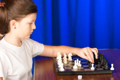 Children play a board game called chess. Stock Photo
