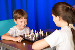 Children play a board game called chess. Stock Image