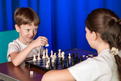 Children play a board game called chess. Royalty Free Stock Images