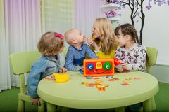 Children play board games stock images
