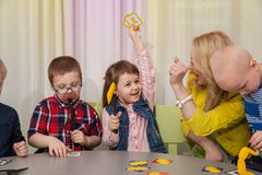 Children play board games royalty free stock image