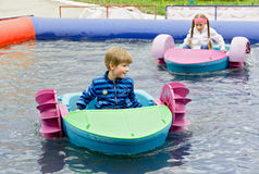 Children at play on a boat attraction Royalty Free Stock Photos