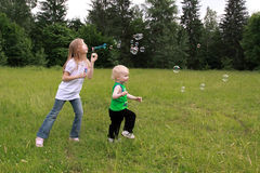 Children play with bubbles Stock Photo