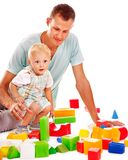Children play building blocks. Stock Images