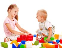 Children play building blocks. Stock Photo