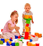 Children play building blocks Royalty Free Stock Photography