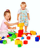 Children play building blocks. Royalty Free Stock Photography