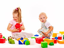 Children play building blocks. Stock Photos
