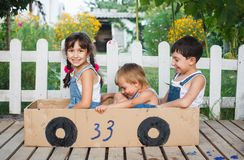 Children play in the car Royalty Free Stock Photo