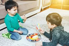 Children play card game together. On the floor in the morrning royalty free stock photos
