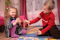 Children play cards in playroom Royalty Free Stock Photos