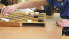 Children play checkers at a kindergarten. Close-up stock video footage