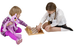 Children play chess. On the white background Stock Photo