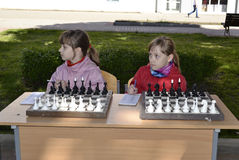 Children play chess. Children in anticipation of a simultaneous game with the master of sports Royalty Free Stock Images
