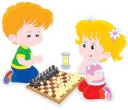 Children play chess Stock Photo